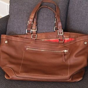 Coach brown laptop bag with red lining